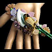 """Vintage 5.25"""" Stanley Hagler Purple and Clear Rhinestones Seed Beads Parrot Brooch"""