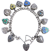 Victorian and 1940s Enamel English Sterling Silver Puffy 12 Hearts with Heart Lock Charm Bracelet