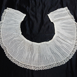 Antique pleated cotton batiste with lace edge.  Dolls