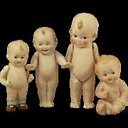 Four Vintage German all Bisque Googly Dolls