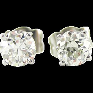 Transitional Cut Diamond Stud Earrings in Platinum. Vintage 0.84 ctw Diamonds Set in Modern 4 Claw Basket Platinum Mounts.