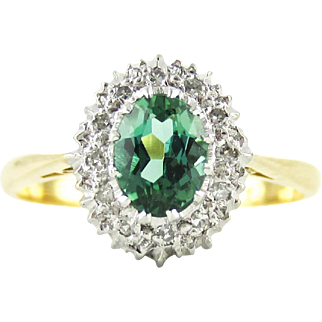 Vintage Tourmanline Ring, Green Oval Cut Tourmaline with Diamond Halo. Mid Century Cluster Ring in 18 Carat Gold & Platinum.