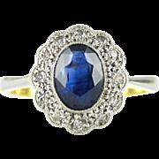 Edwardian Sapphire & Diamond Engagement Ring, Oval Cut Blue Sapphire with Diamond Halo. Circa 1900, 18ct and Platinum.