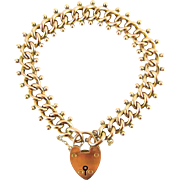 Edwardian 9 Carat Rose Gold Curb Link Bracelet with Heart Padlock Clasp with Heart Shaped Clasp, Hallmarked 1900s.