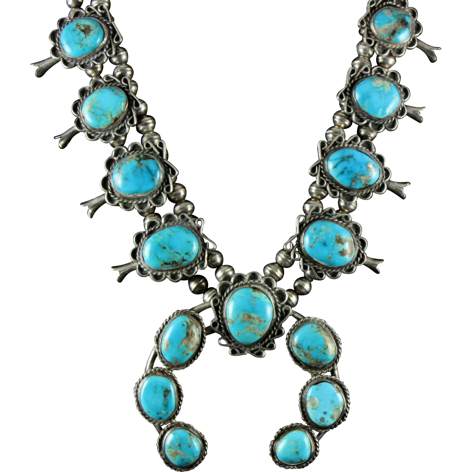 big squash blossom necklace with vibrant blue turquoise