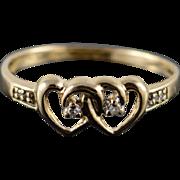 10K 0.03 CTW Diamond Interlocking Heart Band Ring Size 8 Yellow Gold