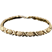 "10K Hollow Hugs & Kisses Link Bracelet 7.25"" Yellow Gold"