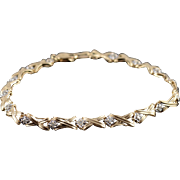 "10K 0.16 Ctw Diamond Grooved Criss Cross Tennis Bracelet 7.25"" Yellow Gold"