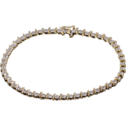 "10K 0.25 Ctw Diamond Starburst Wavy Tennis Bracelet 7.25"" Yellow Gold"