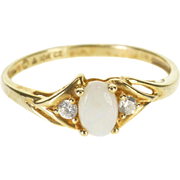 10K Opal* Oval Cabochon Cubic Zirconia Bypass Ring Size 7 Yellow Gold