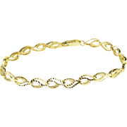 "10K Textured Wavy Curvy Loop Link Tennis Bracelet 7.25"" Yellow Gold"