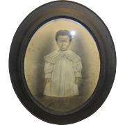Wonderful Antique Charcoal Civil War Era Painting of a Beautiful African American Little Girl In A Oval Shaped Frame