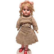 Beautiful German Bisque Armand Marseille girl on composition body
