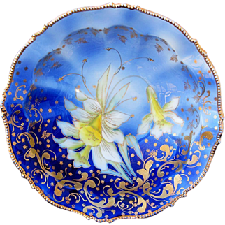 "R.S. Prussia 10 ½"" Cobalt Blue Bowl w/Yellow Daffodils & Gold"