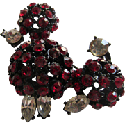 Posh Poodle Brooch with Red and Clear Rhinestones in a Japanned Setting