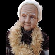 Bisque Elderly woman artist doll.
