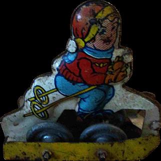 "Tiny 2"" Vintage Tin Metal Roller Rolling Wheeled Toy Boy Skies Skiing"