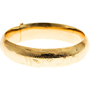 14 Karat Yellow Gold Engraved Hinged Bangle Bracelet Circa 1960s