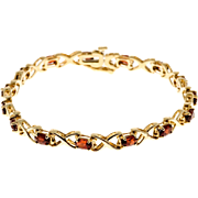 "Oval Garnet ""X"" Design 14 Karat Yellow Gold Hinged Link Bracelet"