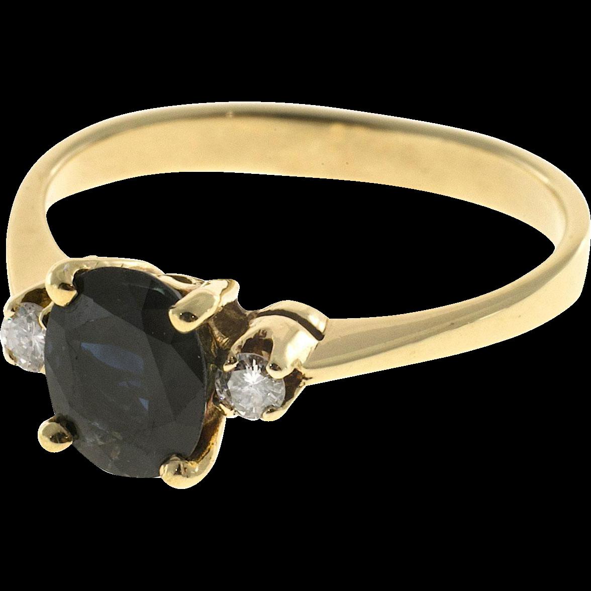 Deep Blue Oval Sapphire Diamond 18 Karat Gold Engagement Ring