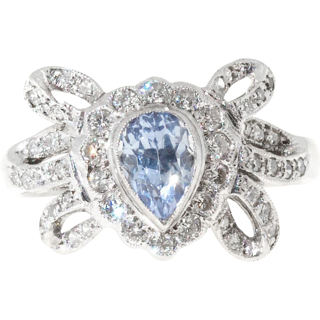 Pear Shaped Sapphire Round Diamond Swirl Bow Design Platinum Ring