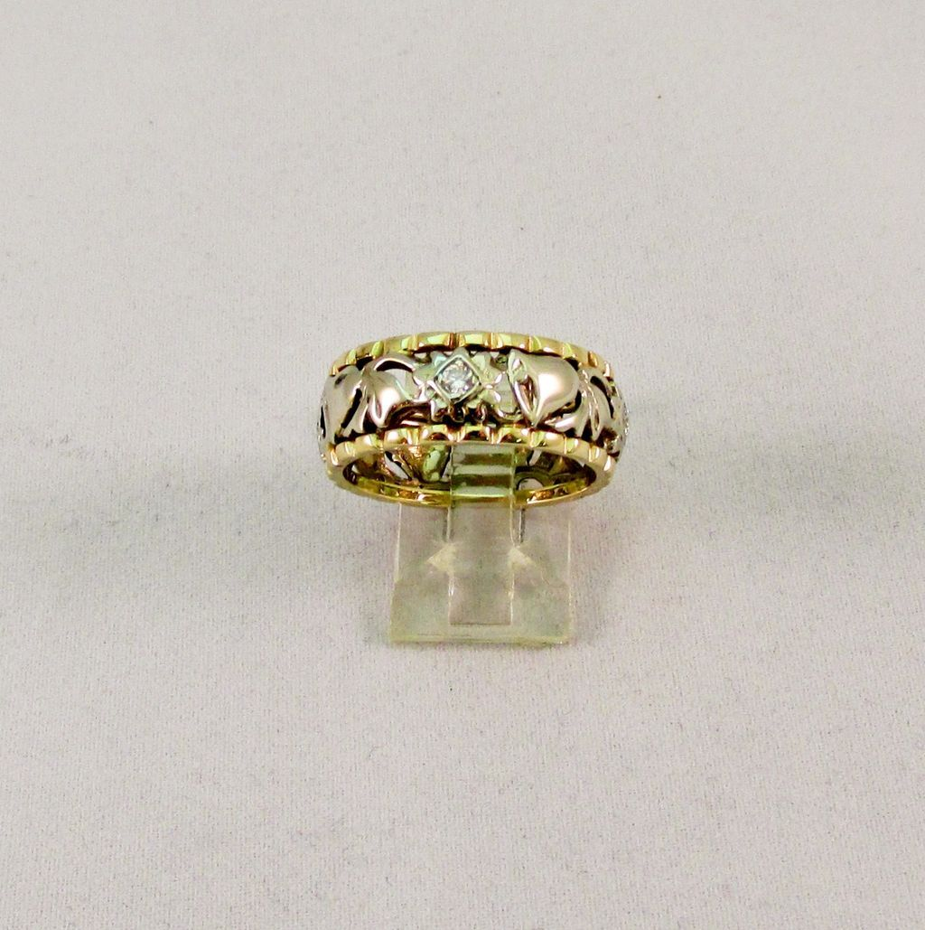 14 Karat Yellow and White Gold Carved Wedding Band