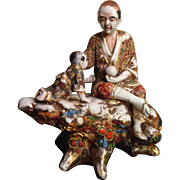 Japanese Vintage Satsuma Moriage Ornament Statue of a Man and a Baby