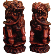 Chinese Vintage Pair of Wood and Resin Shishi Lion Ornaments or Statue