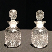 Pair of Early American Pressed Glass Bottles with Glass Stoppers