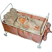 Deco Era Iron Crib, Dressings and Bisque doll