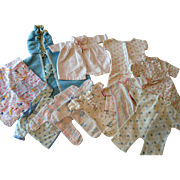13 Piece Assortment of Baby Doll Jammies, Sleepers, Buntings, and Esmond Blanket