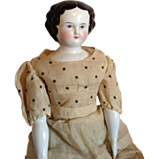 C. 1860s Flat Top China Head Doll