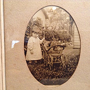 Early 20c. Photo of Child and Teddy in Wicker Carriage
