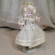 Early 20c. All Bisque Doll with Mohair Wig