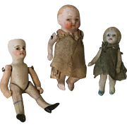Three Wee All Bisque Jointed Dolls