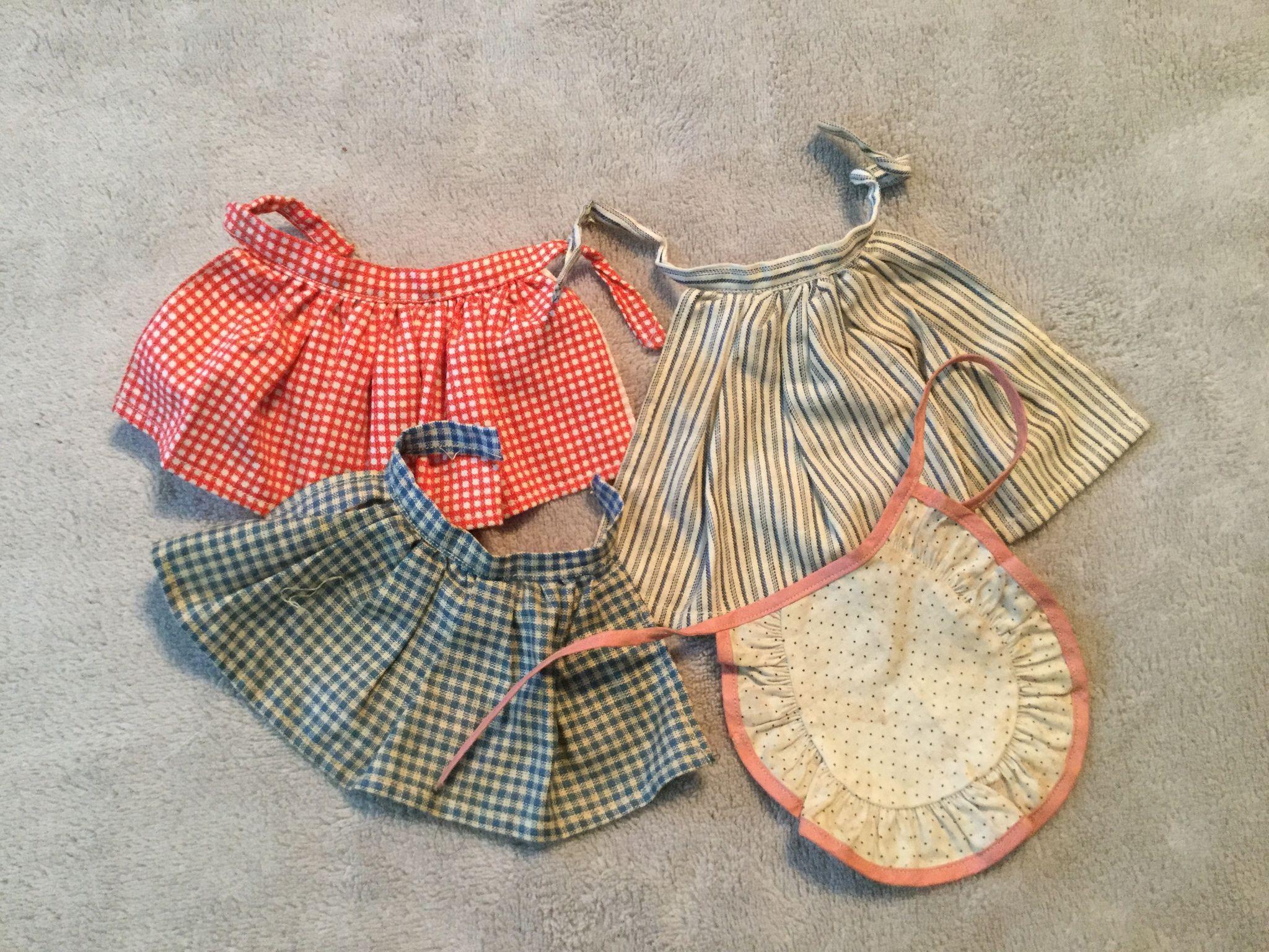 Four Vintage Doll Aprons