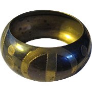 A Bold, Black and Gold Coloured, Brass Bracelet