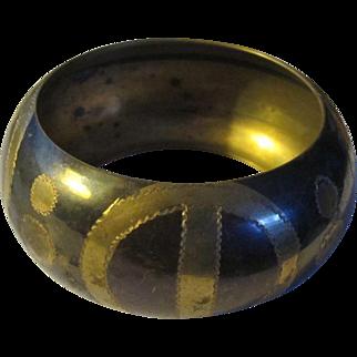 A Bold, Black and Gold Coloured, Brass Bracelet