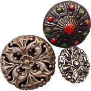 A poke of three Victorian buttons