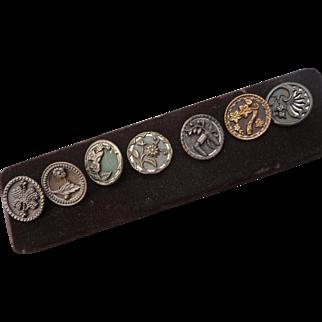 A Set of Seven Vintage Brass Flower Buttons