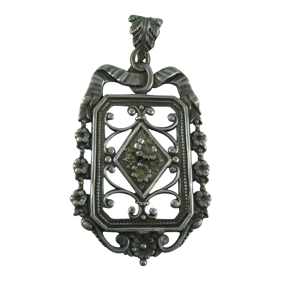Delicate Silver flower pendant