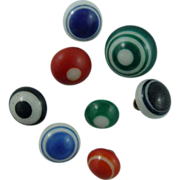 Eight Vintage Bullseye China Buttons