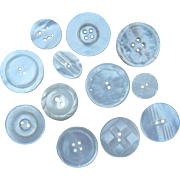 A Poke of 12 Vintage Pearl Buttons