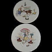 Wonderful pair of Sarreguemines Plates with  colored scenes transferware