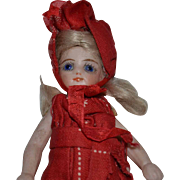 Pretty French mignonette with original costume,all bisque doll.