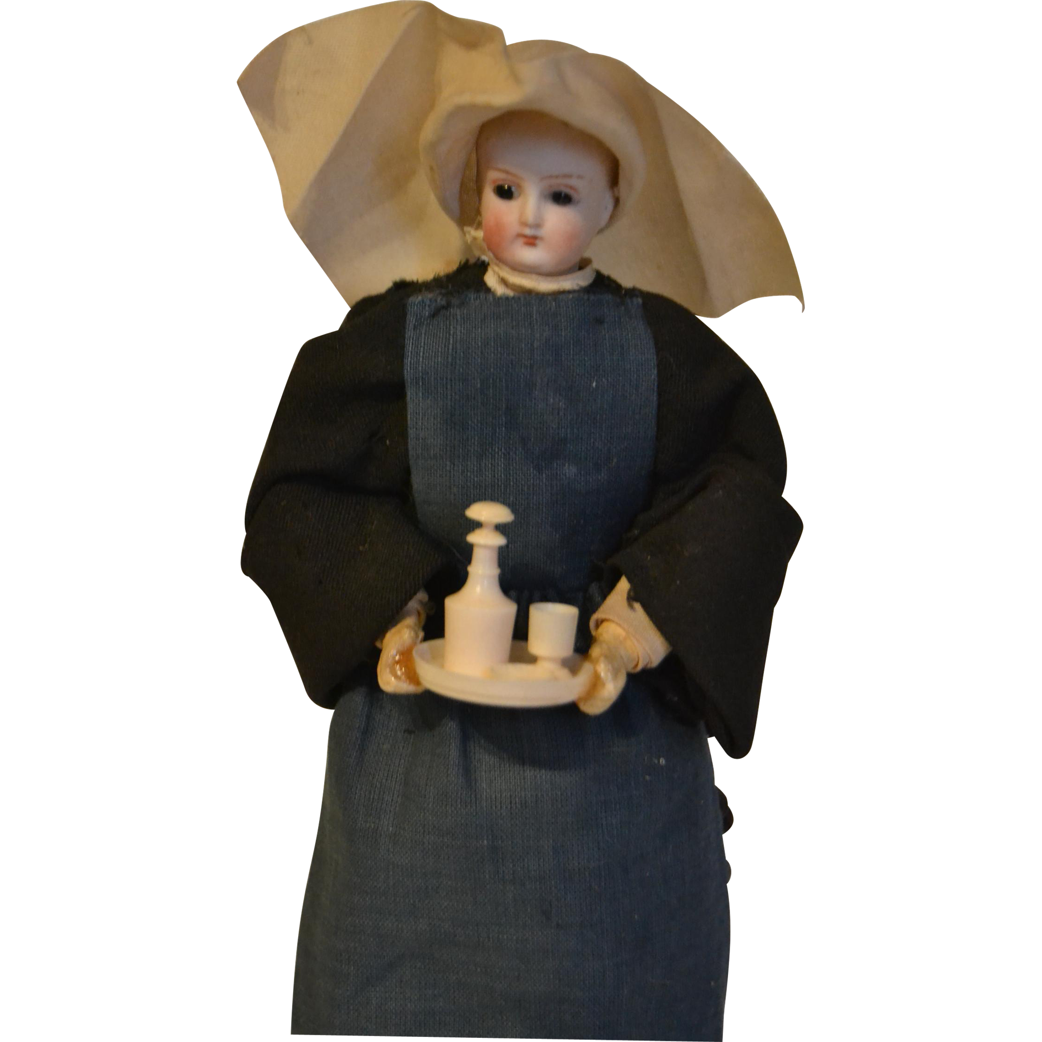 Rare  19 century nun with bisque head and lovely accessories