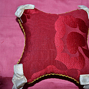 French antique  red  and metal trimmed catholic coussin