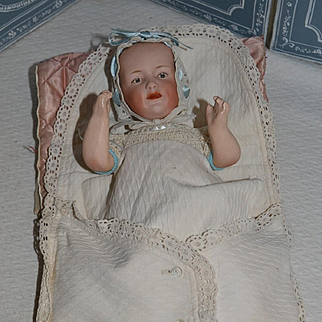 Gebruder Heubach character in his layette, charming piece
