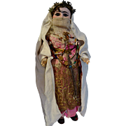 An all-original French doll   in silk turkish court costume.
