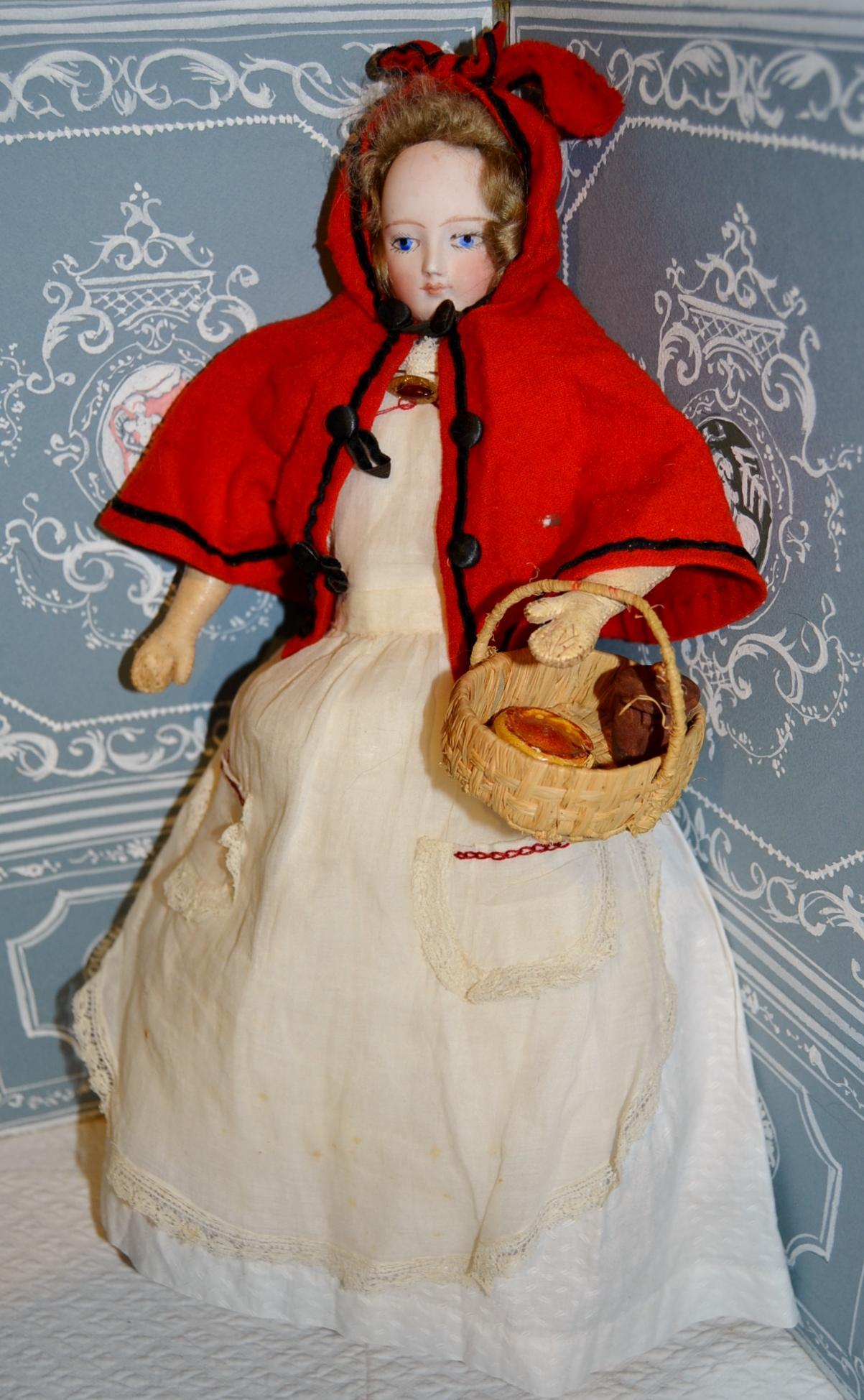 French fashion doll in little red riding hood outfit